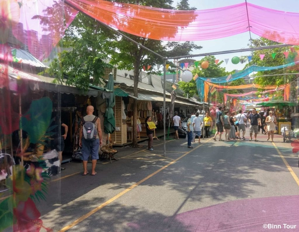 main street with visitors inside of Chatuchak market