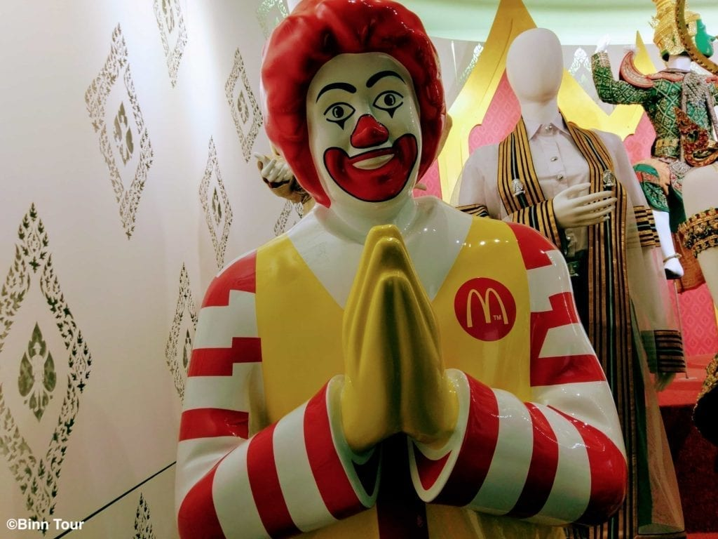 Ronald McDonald greeting with a wai