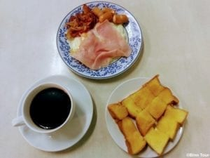 breakfast at On Lok Yun with coffee, bread, egg and ham