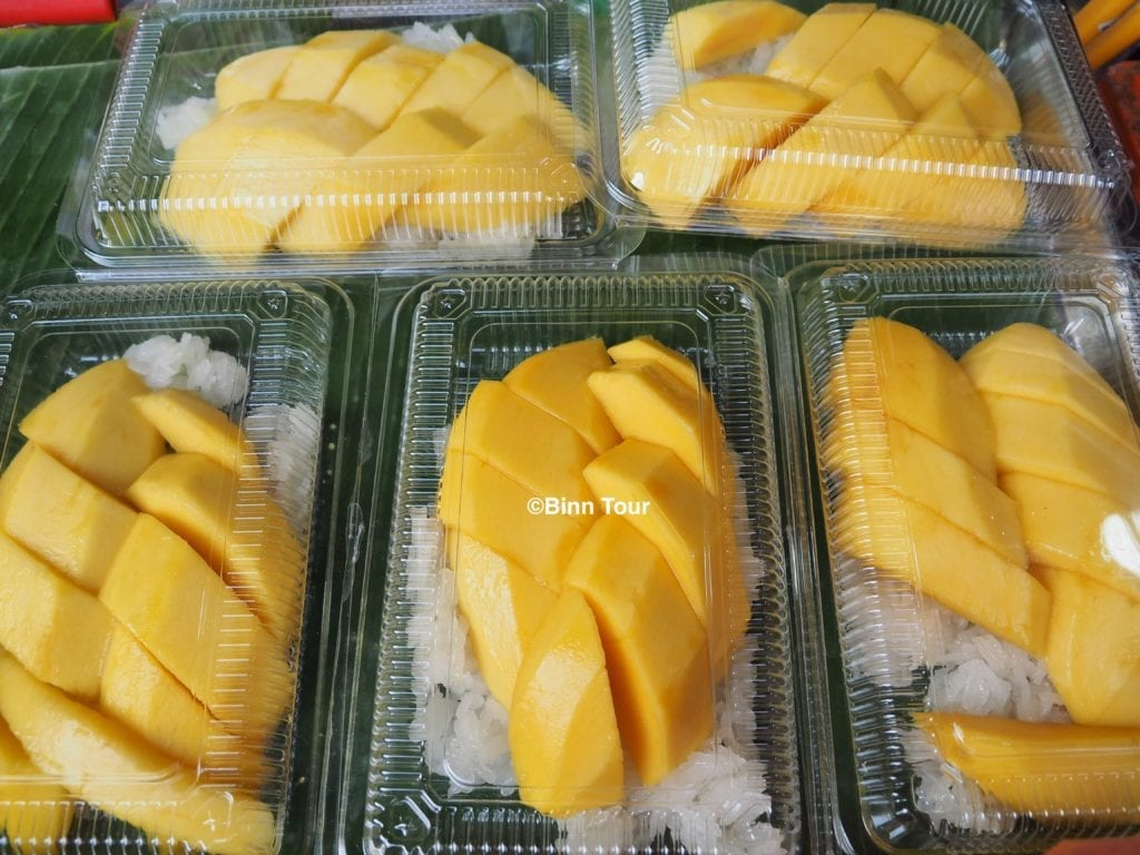Boxes of Thai mango with sticky rice sold on the street