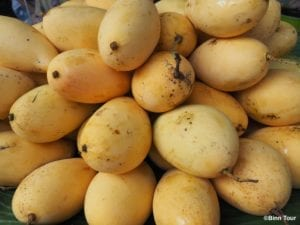 Thai mangoes piled up on each other