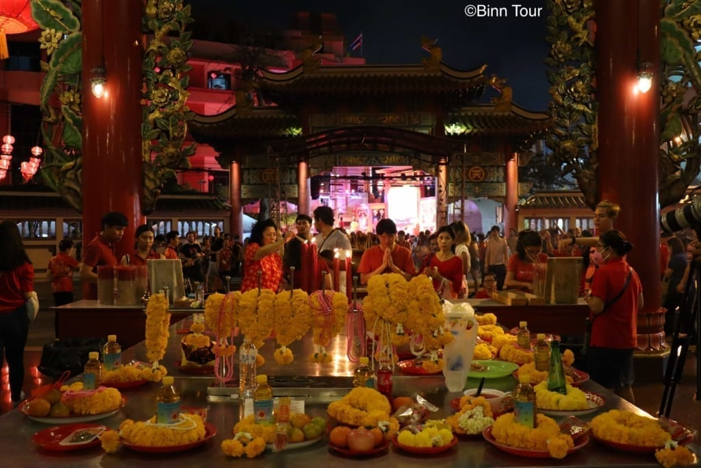 Worshippers at Kuan Yin Shrine in Bangkok's Chinatown